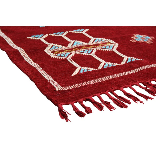 Handwoven Moroccan Berber kilim with geometric shapes and symbols. Luxuriously rich red color will add the warmest of...