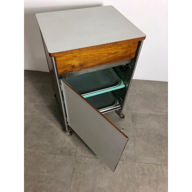 Turquoise 1950s Raymond Loewy Hill-Rom Walnut & White Laminate Rolling Cabinet For Sale - Image 8 of 10