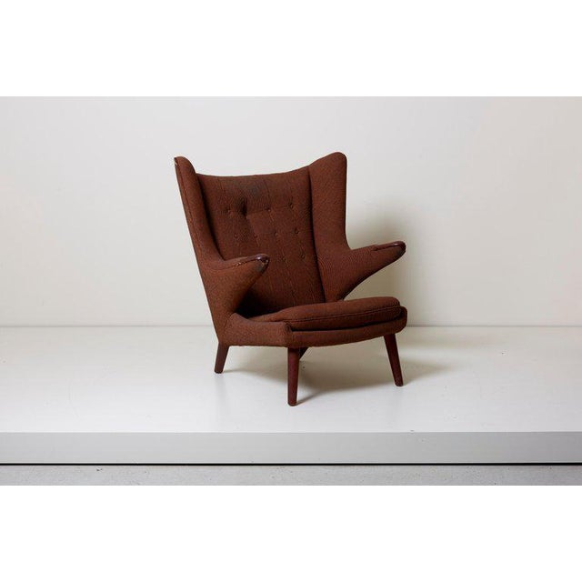 Papa Bear chair by Hans J. Wegner. This model has Teak nails and legs. Upholstered with brown fabric. Need to be upholstered.