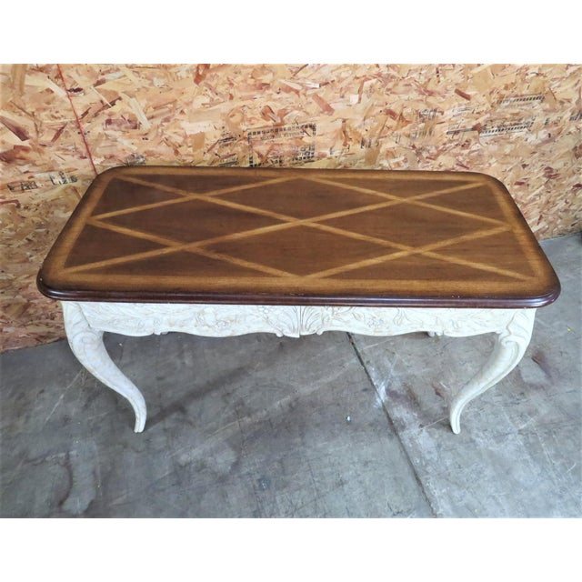 French style console table with parquetry inlaid walnut top , 2 drawers , faux painted cream marbleized base carved with...