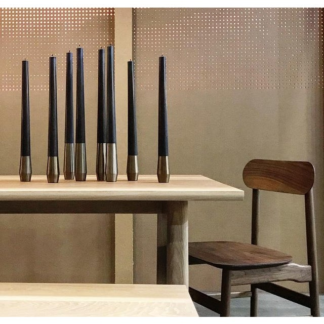 2 heat treated steel bases, with corresponding black 100% beeswax candles. Barter Design hails from British Columbia....