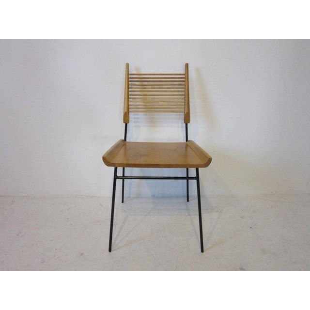 A set of four solid maple shovel seat or ladder back dining chairs with spindle design to the backrest , wood seat and...