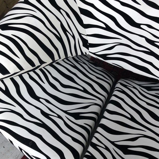 This zebra chair with ribbon features is a perfect addition to any interior design space.