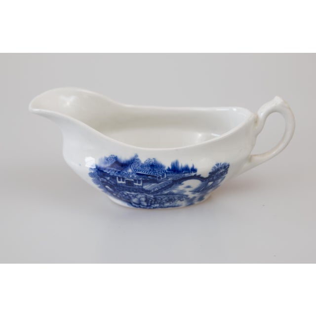 """A charming early 20th-Century English transferware sauce pitcher or gravy boat with landscape scenes. Marked """"England"""" on..."""