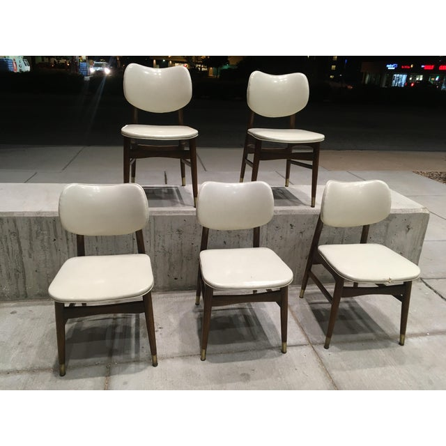 Vintage Thonet style dining chairs, with vinyl seat, and solid walnut frames. One seat is is a bit worn on the vinyl torn,...