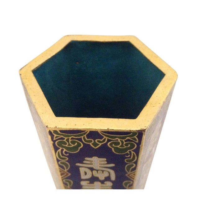 Vintage hexagonal cloisonné vase with a cobalt blue base color, accented with green, white and cinnabar. It is decorated...