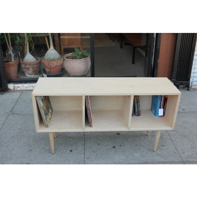 Newly hand made mid-century style maple credenza. The credenza is perfect to store that vinyl collection and or books or...