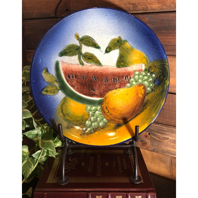 This is for one Mexican hand painted plate with bright colors of : blue, yellows, golds and greens. It has fruit of :...