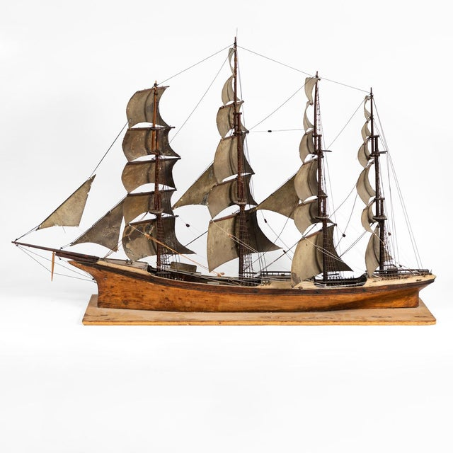 Late 19th century handmade wooden ship model from France.