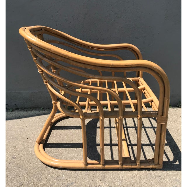 Well styled Rattan lounge chair attributed or in the style of Brown Jordan. Glazed finish to bamboo. All wraps tight. No...