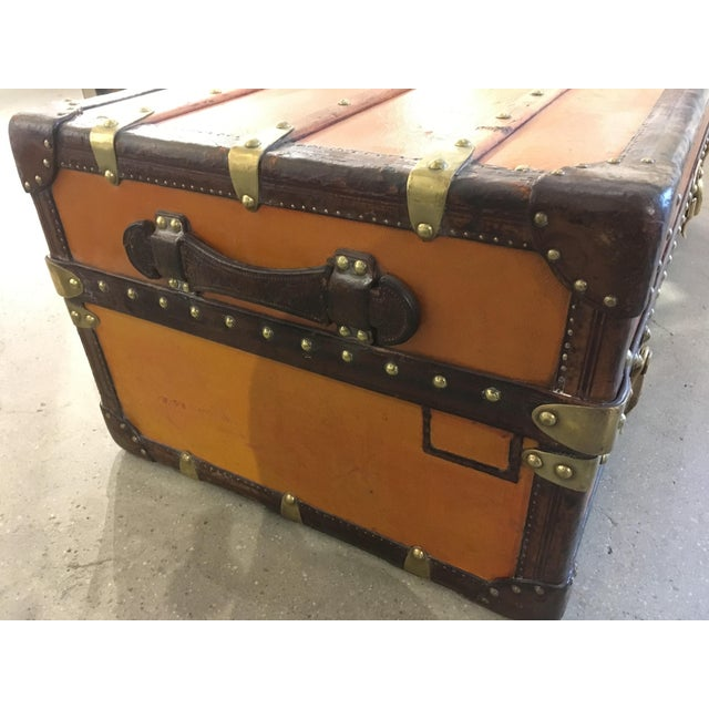 Louis Vuitton wardrobe trunk with orange Vuittonite canvas exterior. Features two drawers, roll-out compartment, removable...