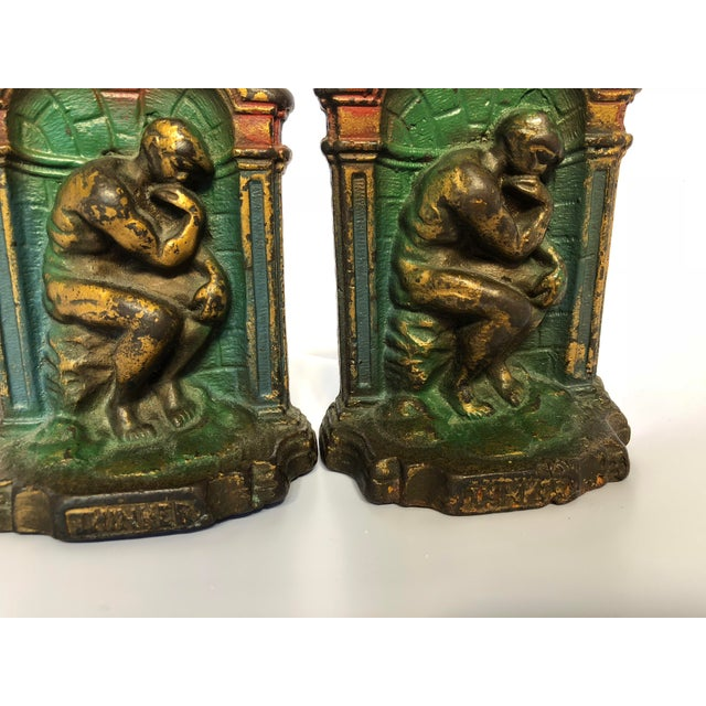 "A heavy pair of matching cast bookends of ""The Thinker""by Rodin. These are heavy cast metal are not reproductions. Details..."