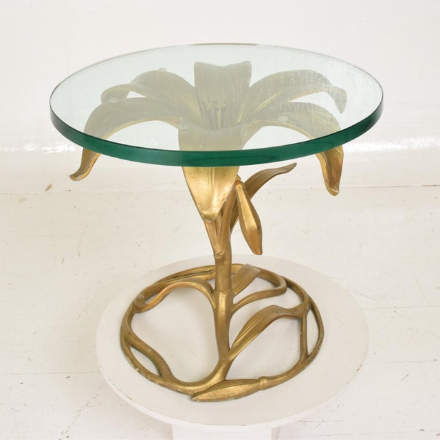For your consideration, a Side Aluminum Table designed by Arthur Court. Gilded Lily design with original round glass top....