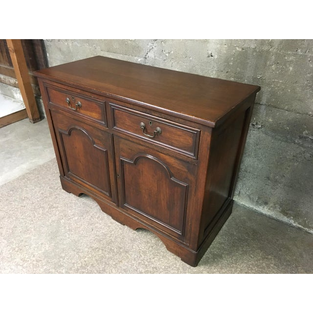 Gorgeous Petite English antique sideboard in solid Mahogany. Circa 1840's. Two drawers with original brass swan neck...