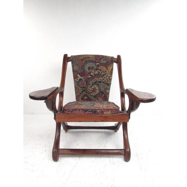 This vintage sculpted frame armchair by designer Don Shoemaker makes an interesting addition to any interior. One of the...