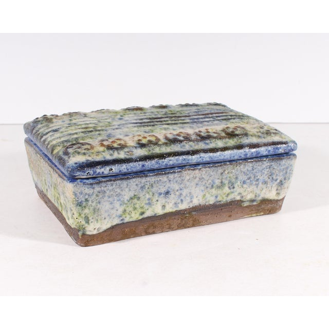 A mid-century ceramic dresser box designed by Alvino Bagni (1919-2009) for Raymor. Made in Italy, the box features a...