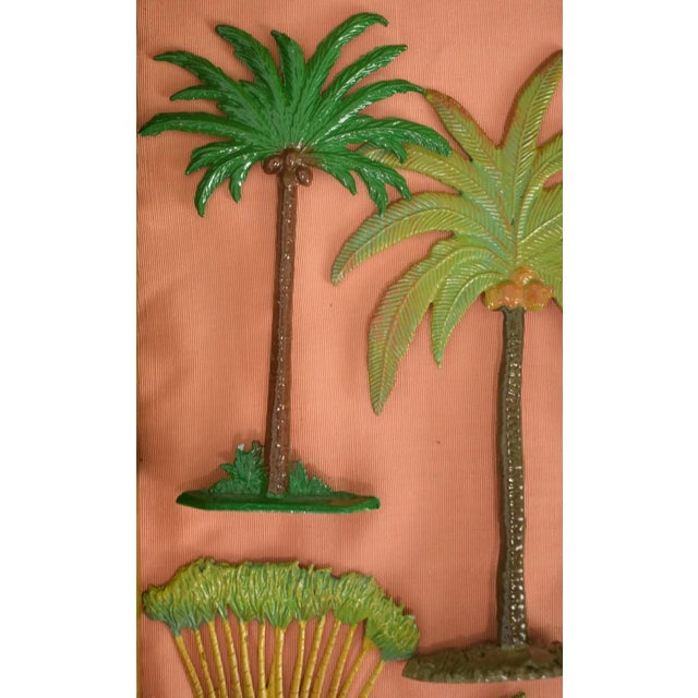 This is a set of 10 vintage palm tree models from the mid 20th century. The pieces have been hand-painted. Each Palm Tree...