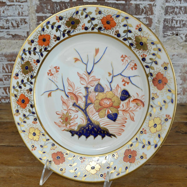 Late Georgian Crown Derby porcelain dinner plate in the Old Japan Pattern featuring a Chinoiserie style floral border and...