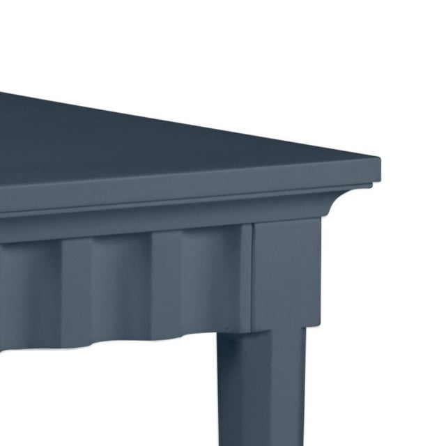 Scallop pattern design on console and finish is Benjamin Moore Hale Navy. Made of acacia wood.