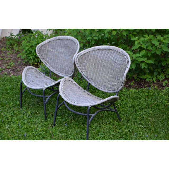Salterini clamshell chairs in natural wicker with black-painted steel frame. A Classic pair. Very good condition. Great...