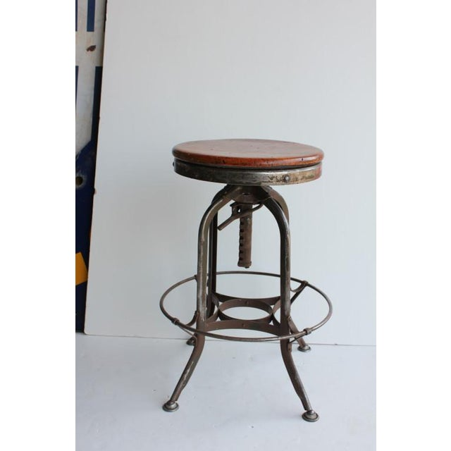 Vintage American Industrial Toledo Swivel stools with iron base and wooden seat.We have more stools available. Price is...