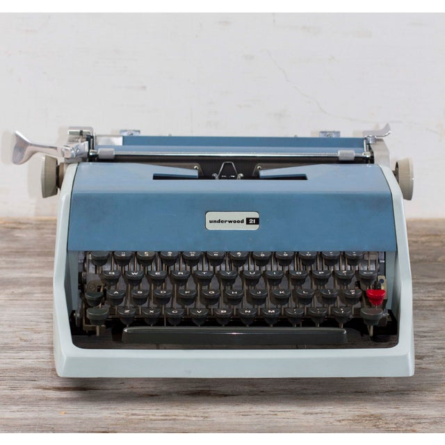 What an awesome find! This is a lovely vintage mid-century Underwood 21 typewriter. Seems to be in full functioning order...