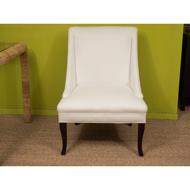 We love the Silhouette of these chairs. Graceful and elegant, they feature a tight upholstered seat and back, with sloped...