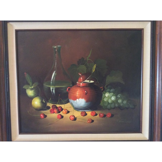 Beautiful Still Life in Oil, signed by Frank Lean. This vivid and luminous oil painting depicts the classic still life of...