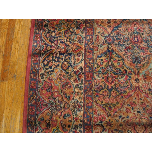 Karastan wool pile rug with floral designs. Made in the USA.
