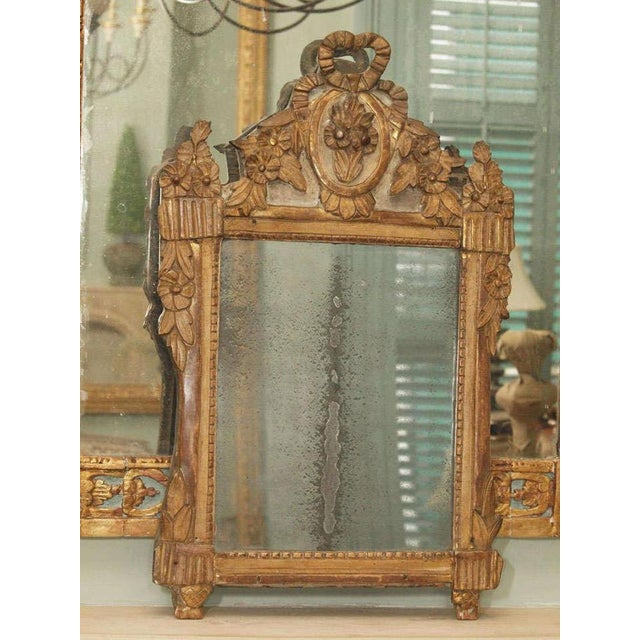 18th century Louis XVI giltwood mirror with original mercury glass.