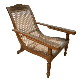 Antique Teakwood and Rattan Plantation Lounge Chair For Sale