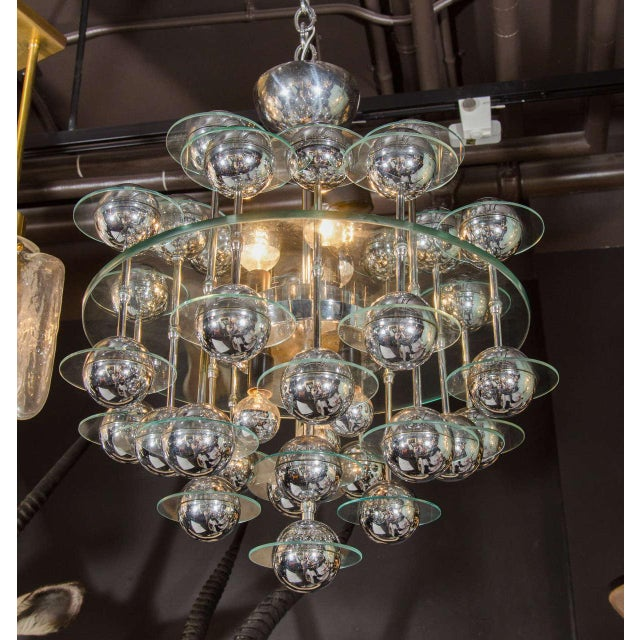 Mid-Century Modern spherical chandelier with Space Age design. Glass centre disc with suspended spheres of chrome globes,...