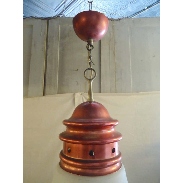 Hanging pendant with frosted white globe and red metal trim. (Please confirm item location - NY or NJ - with dealer)...