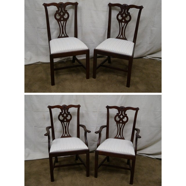 Solid mahogany set of eight Chippendale-style dining chairs by Lexington. High quality, solid mahogany frames are...