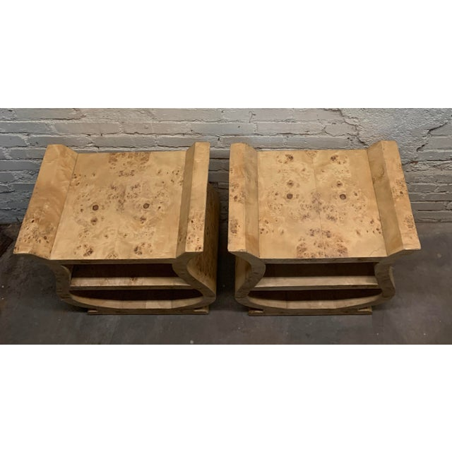 Wrapped in burl veneer, these uniquely shaped side tables are unlike any of their kind. Made in the 1950s.