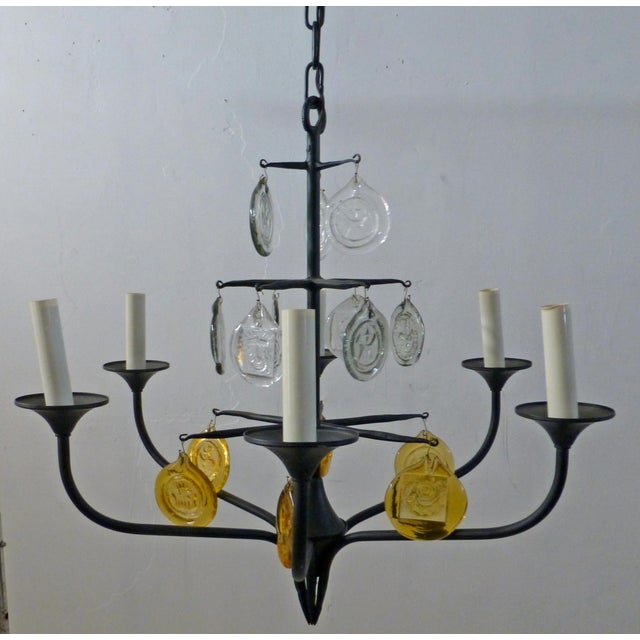 This is a beautiful original Swedish 1960s iron and crystal chandelier designed by Erik Hoglund (1932-1998) and made by...