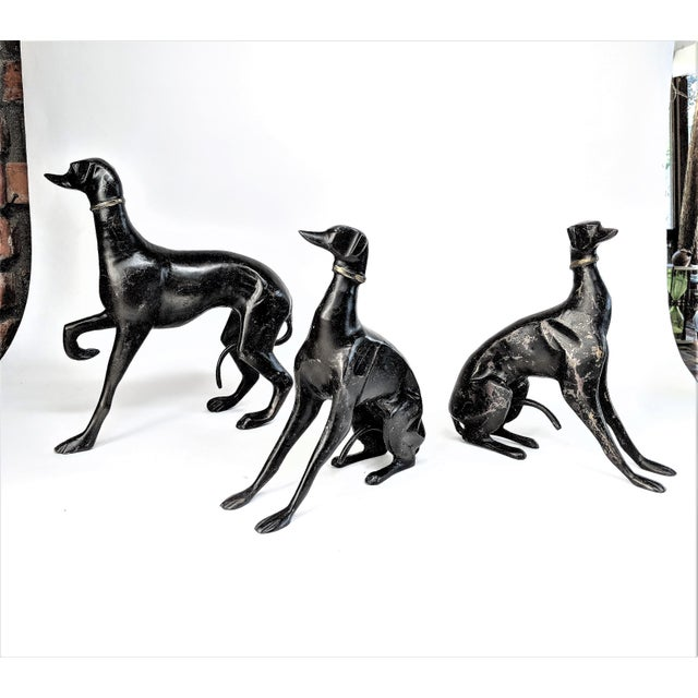 "Elegant set of 3 Greyhound dogs in bronze. Larger dog measures 11""L x 4""W x 12""H. Smaller 2 dogs are the same size and..."