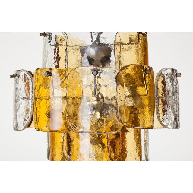 Mazzega clear and amber curved hand blown Murano glass tile chandelier on four tier chrome frame, Italy, 1970s.