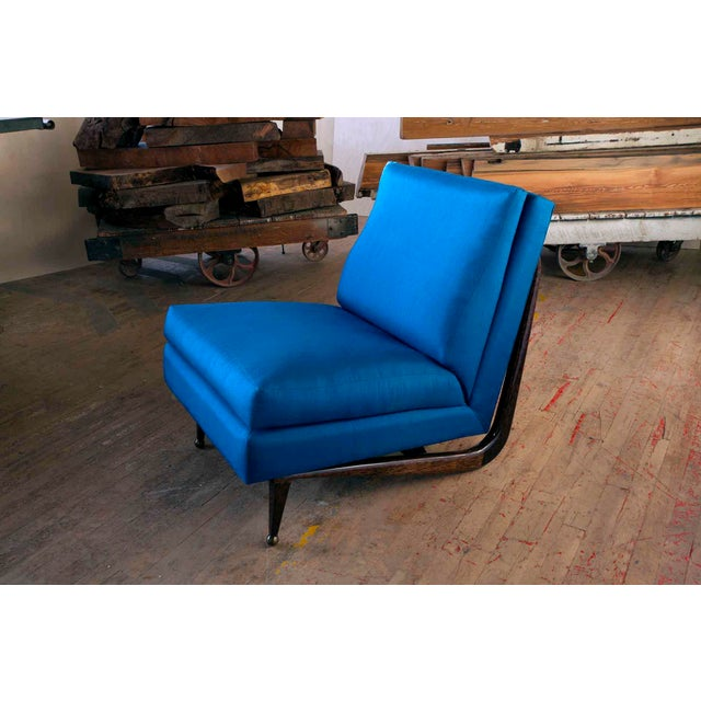 This distinctive lounge chair joins an eclectic palate of materials into a sophisticated and modern form. The seat and...