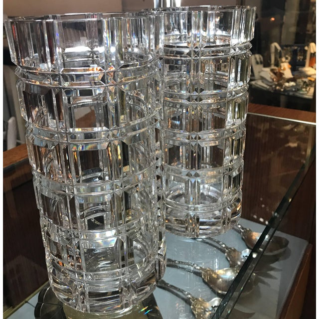 A pair of deep cut crystal window pane pattern cylinder vases. The shimmering mirror like cuts with square panels and...