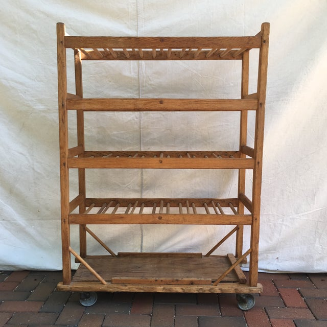 Original unique vintage industrial wooden baker's rack. It glides with ease on disc-shaped solid steel swivel wheels. The...
