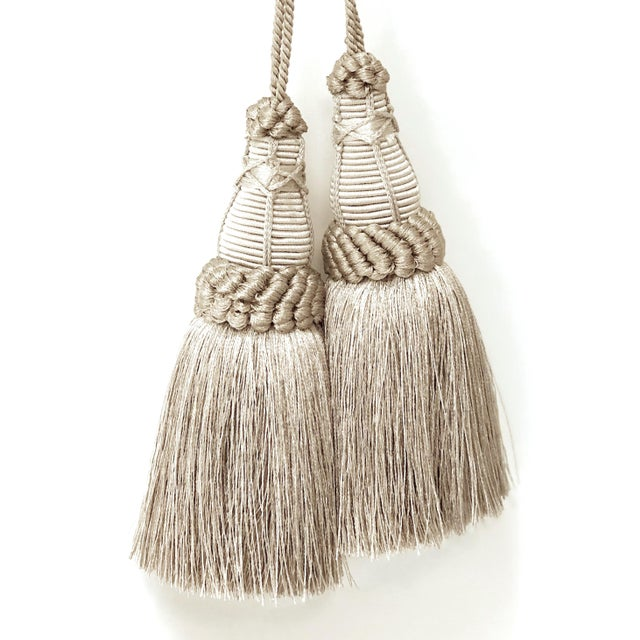 Pair of handmade silver & pewter colored key tassels with looped ruche, twisted cord and full skirt. These have a true...
