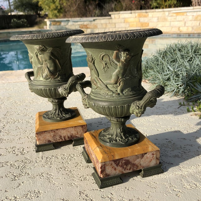Pair of antique Egg and Dart Victorian Planter Urns with marble vases. Both have seals saying made in Paris France. These...