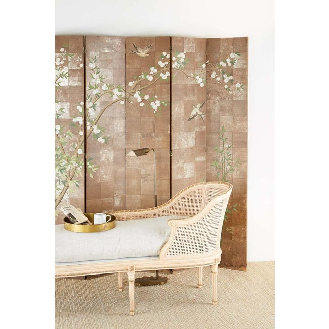 Fantastic chinoiserie style six-panel folding screen featuring a blossoming prunus tree with white flowers painted over...