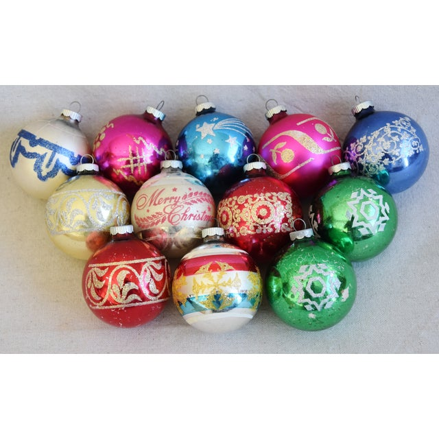 Set of 12 vintage hand-decorated glass Christmas tree ornaments. No maker's mark. Minor scuffs, age wear.
