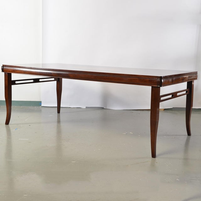 Custom, English made Art Deco style walnut dining table has a polished finish and burlwood center inlay. Open work...