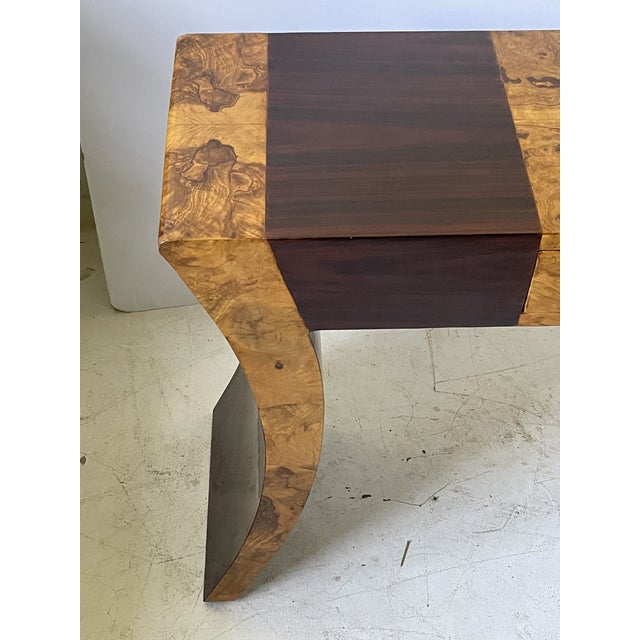 Stylish Midcentury Italian table top holding one drawer over solid flared tapering legs. The table is beautifully veneered...