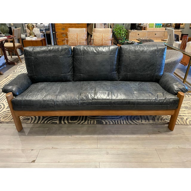 This wonderful MCM Danish sofa has been reupholstered in black leather. Original unaltered base with new cushions and...