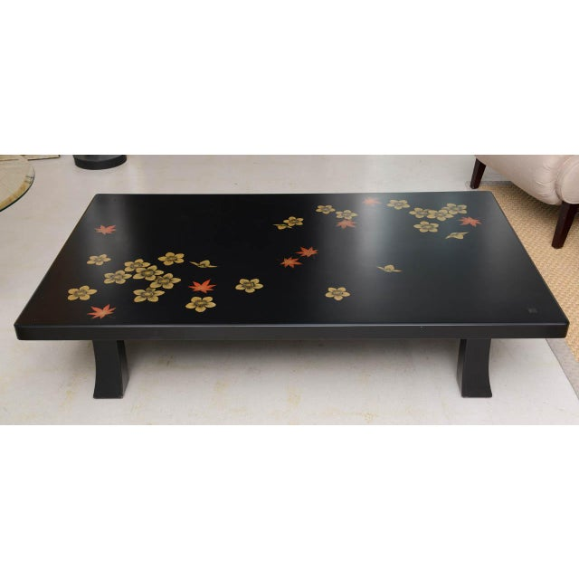This listing is for a charming black Asian style coffee table with a tonal flower motif. This piece has been...