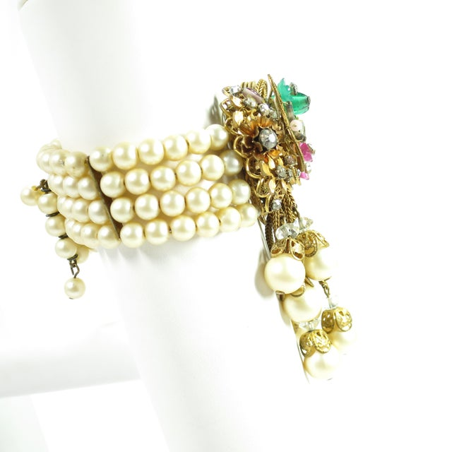 Offered here is a Miriam Haskell faux pearl, crystal, and art glass bracelet from the 1950s. Let's start with the easy...